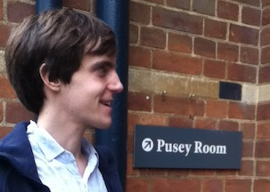 Matt & a sign for the 'Pusey Room'